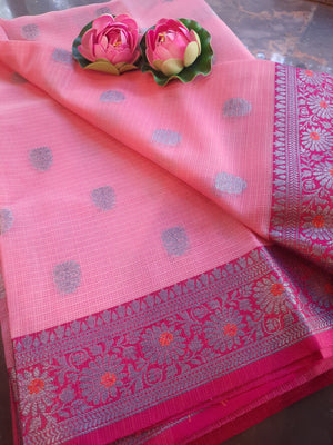 Pink kota saree with silver zari weaving on pink border and silver booties all over