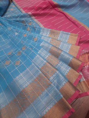 Sky blue check chanderi saree with golden and silver zari weaving and golden and silver booties all over