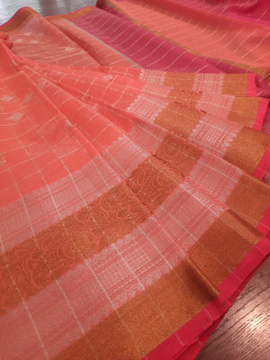 Peach check chanderi saree with golden and silver zari weaving and golden and silver booties all over