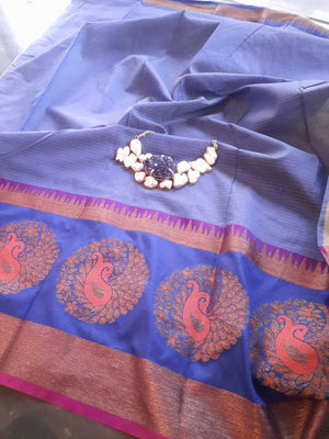 Light yellow chanderi saree with blue border with multicolor motifs on it