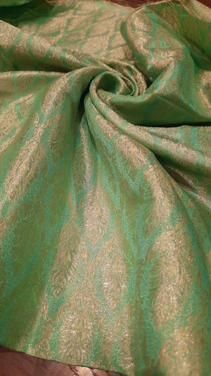 Green pure silk blouse fabric with golden weaving allover