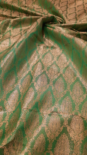 Green pure silk blouse fabric with golden motifs all over