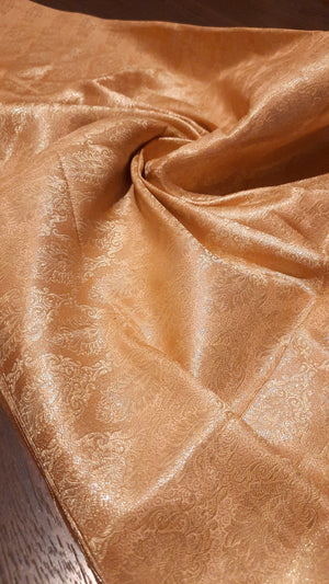 Light orange pure silk blouse fabric with golden motifs all over