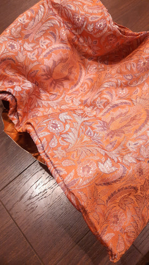 Orange pure silk blouse fabric with silver motifs all over