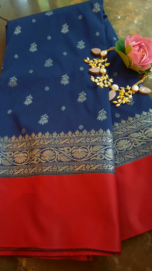 Navy blue soft silk saree with silver zari weaving and red border