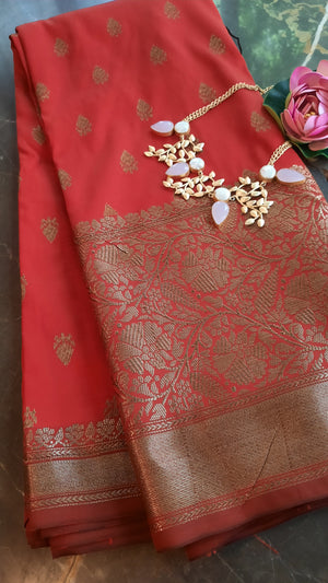 Red soft silk saree with golden zari weaving and booties allover
