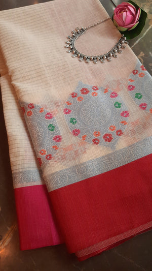 Cream kota saree with silver motifs and red border