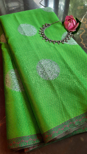 Green kora tanchui saree with silver booties allover