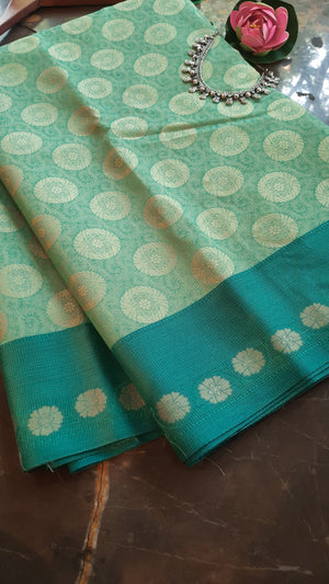Light green kota saree with green border and motifs allover