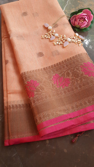 Orange kota saree with golden zari weaving and booties allover