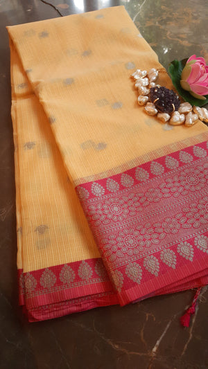 Yellow kota saree with silver zari weaving and booties allover