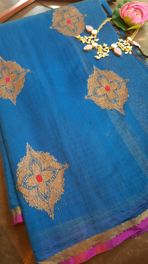 Blue silk saree with goden booties allover and pink small border