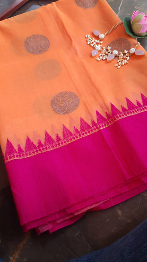 Orange katan tussar silk saree with golden booties allover and pink border
