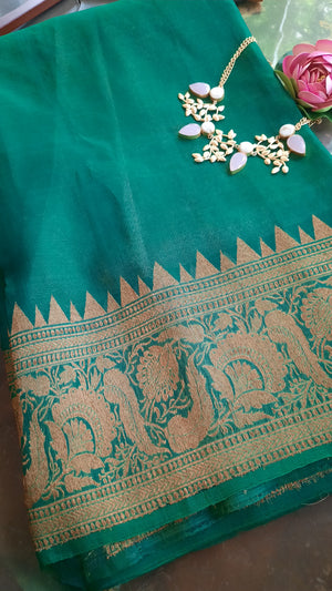 Green katan tussar silk saree is golden zari weaving