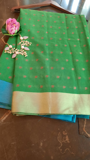 Green chanderi saree with green and blue border and booties allover