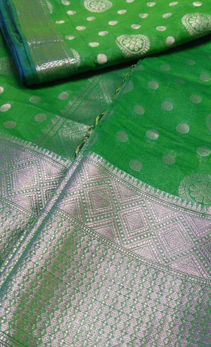 Green chanderi saree with wide silver zari border and butties allover - EthnicRoom