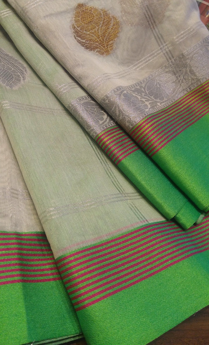 White chanderi saree with allover golden and silver butties and light green border