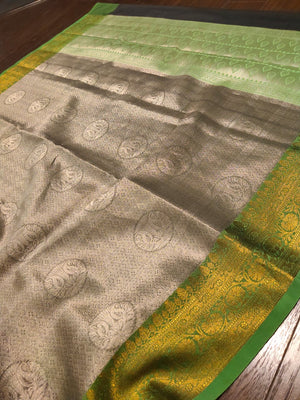 Dark grey tanchoi kora saree with green border with golden zari weaving - EthnicRoom