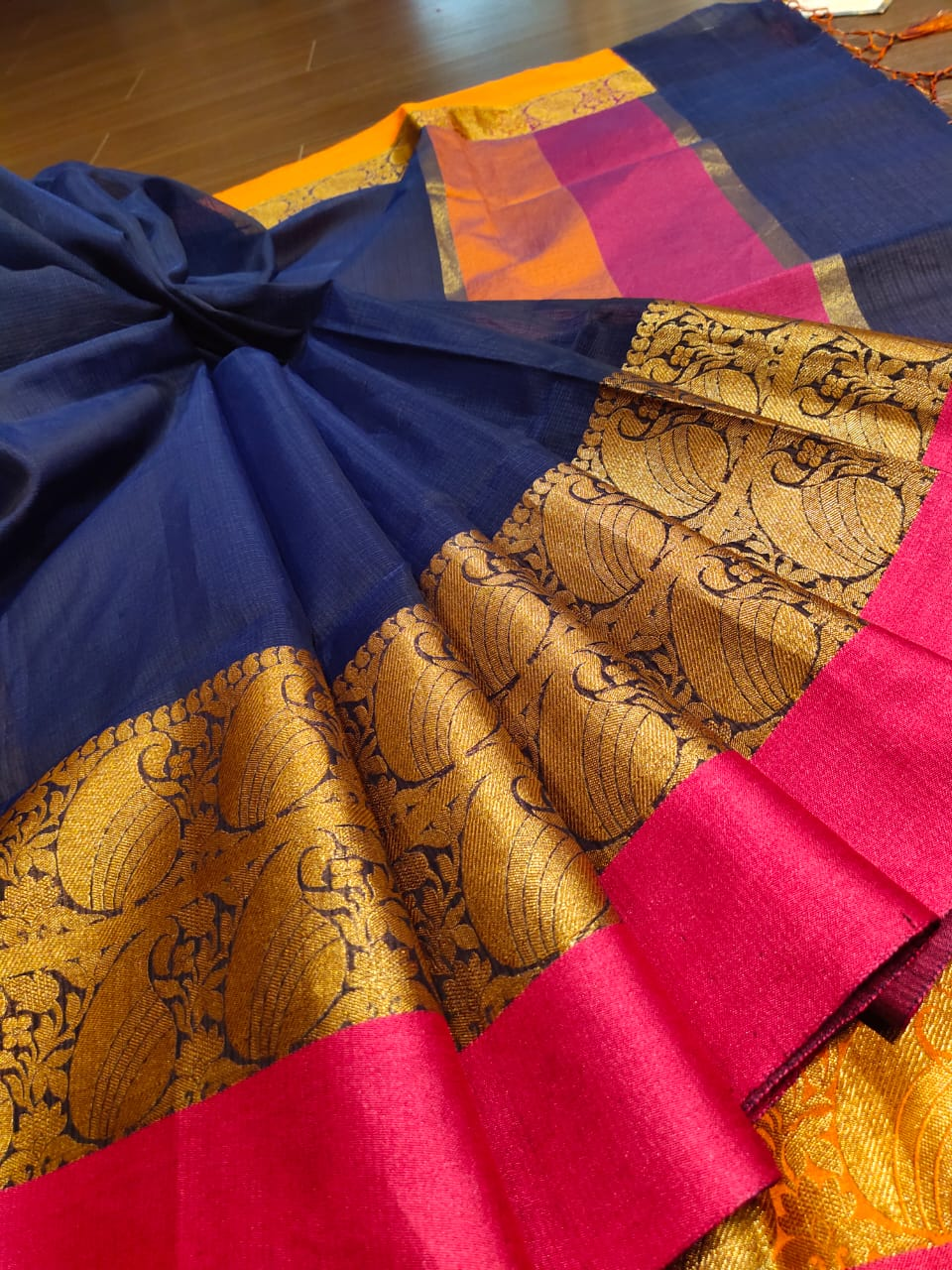 Navy blue kota saree with golden zari weaving and pink border
