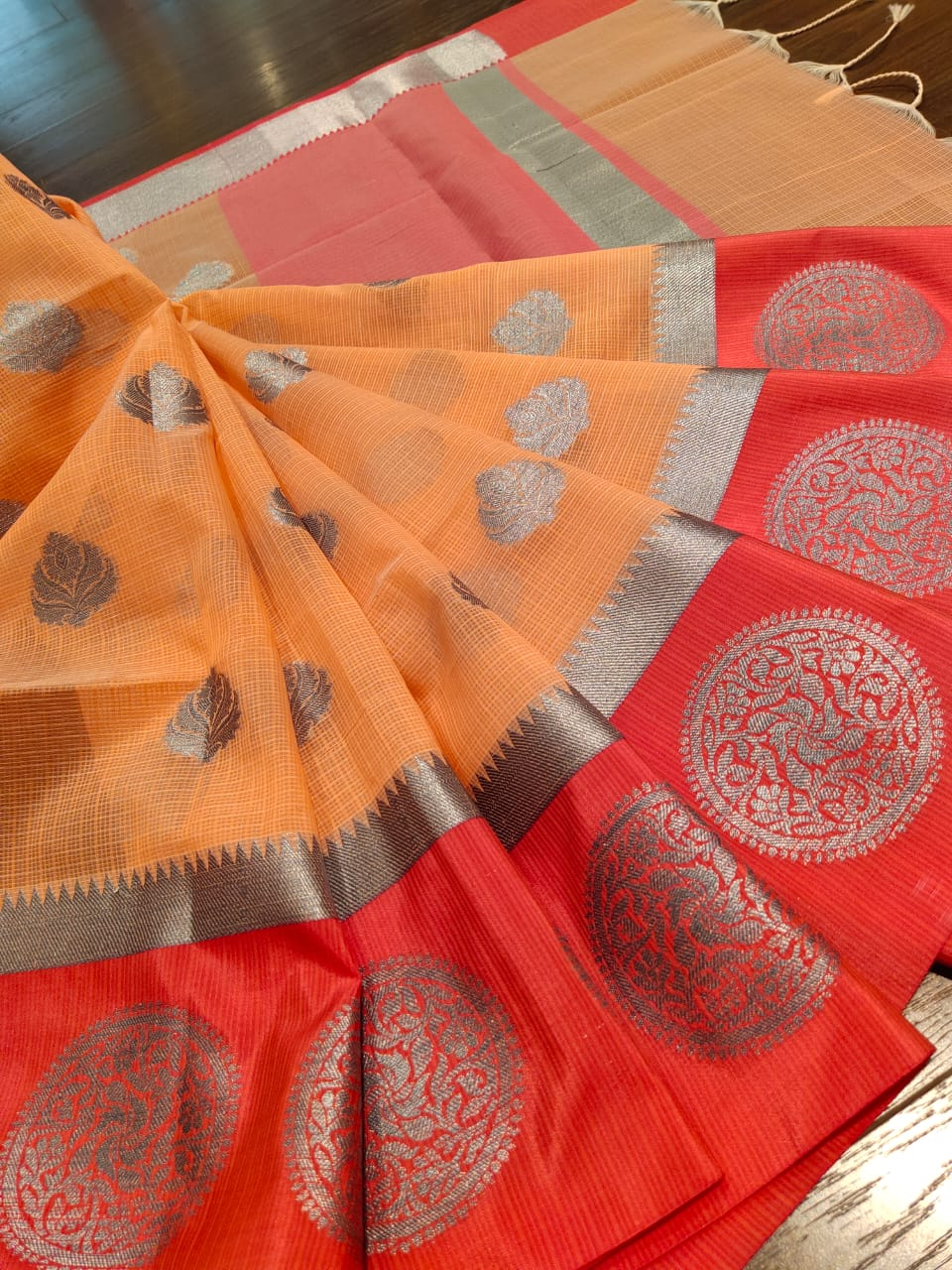 Orange kota saree with silver butties all over
