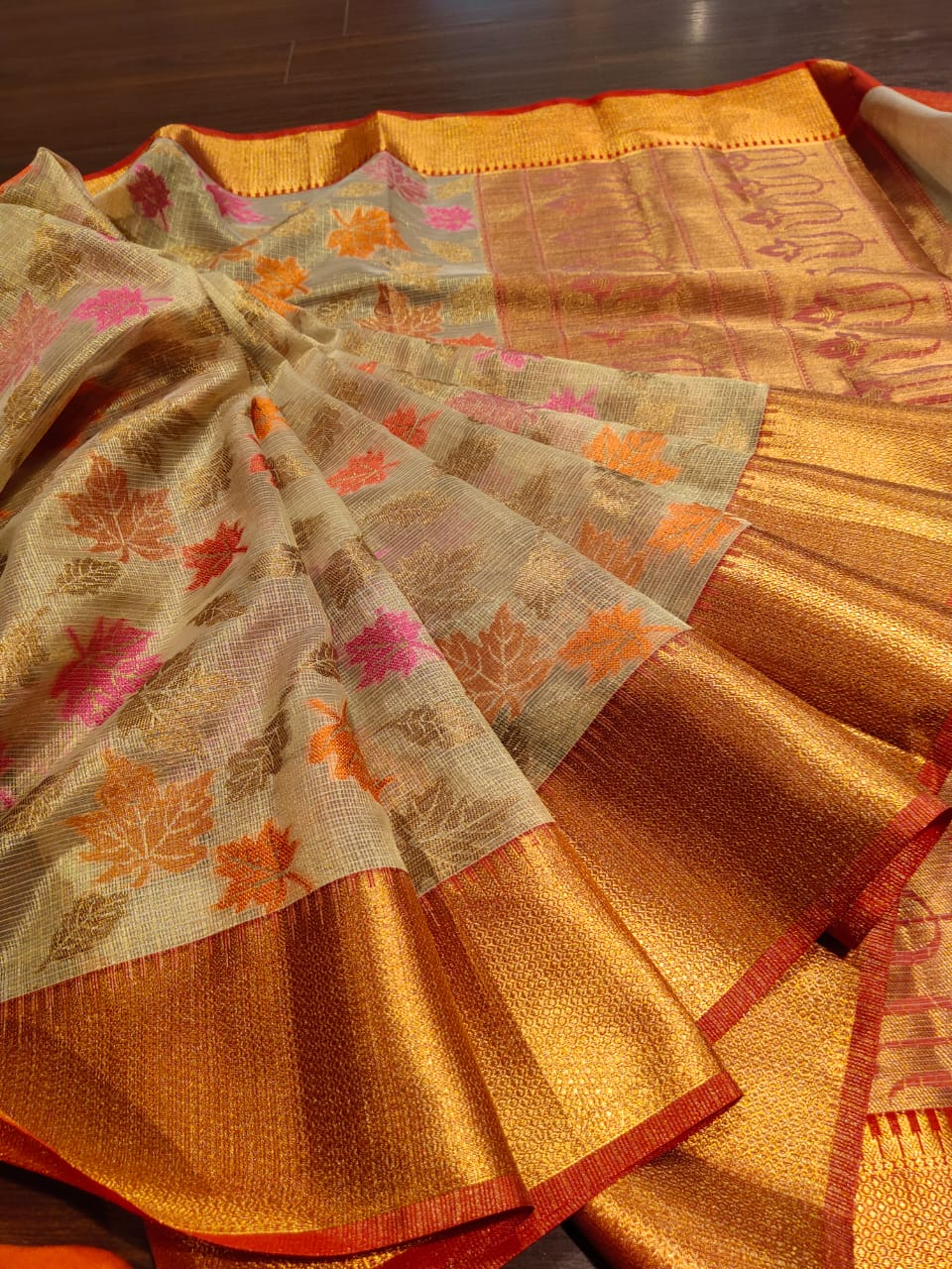 Off white kota saree with golden zari weaving