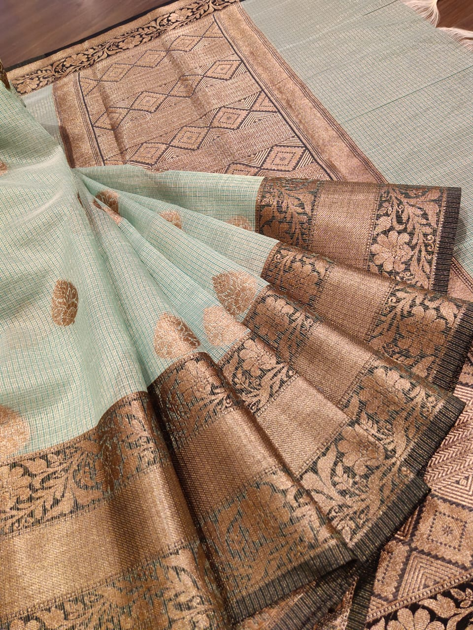 Light green kota saree with golden zari weaving and butties all over