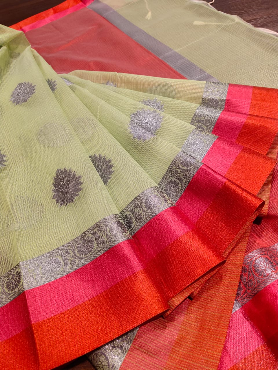 Light green kota saree with silver zari weaving and red border