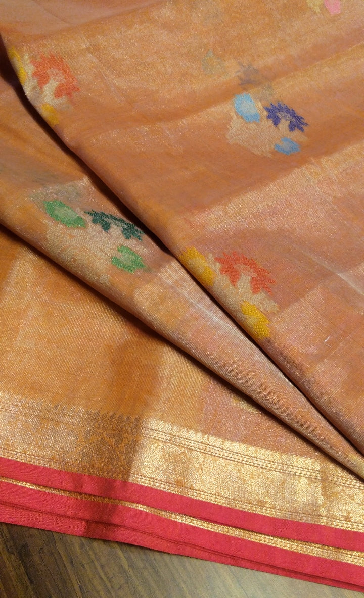 Orange linen zari saree with multicolor floral motifs