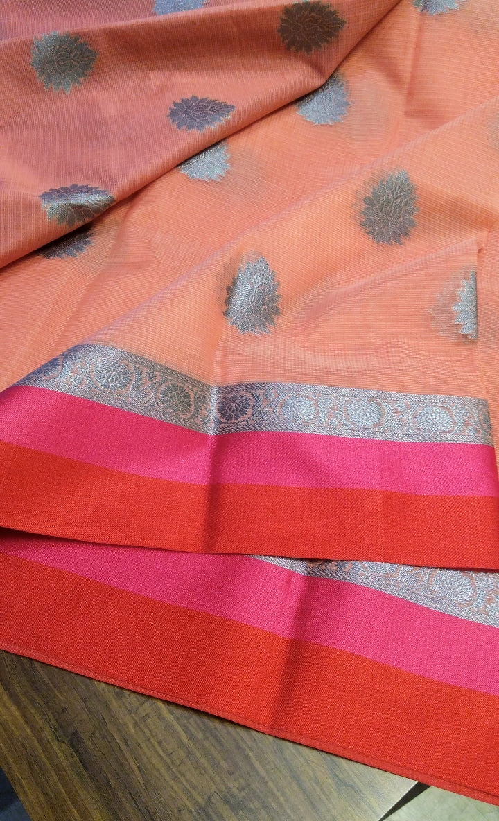 Peach kota saree with allover silver zari butties contrasting aanchal and blouse