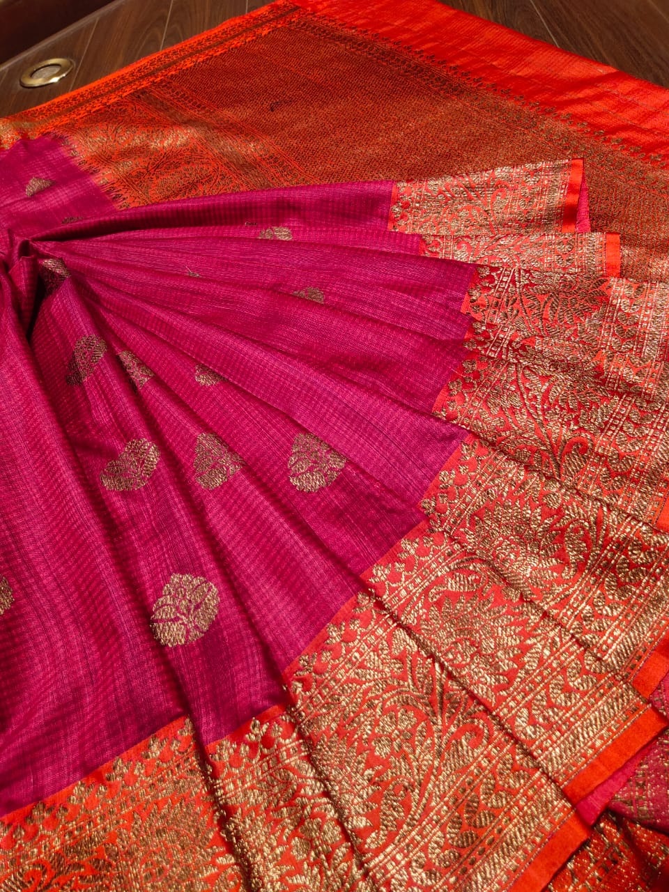 Pink dupion silk saree with golden zari weaving and butties