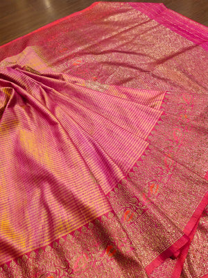 Yellowish pink dupion silk saree with golden zari weaving and butties
