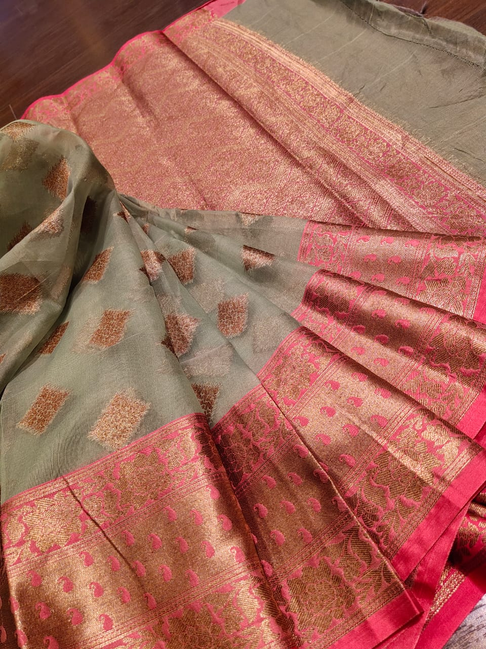 Grey kora saree with golden butties and golden zari weaving