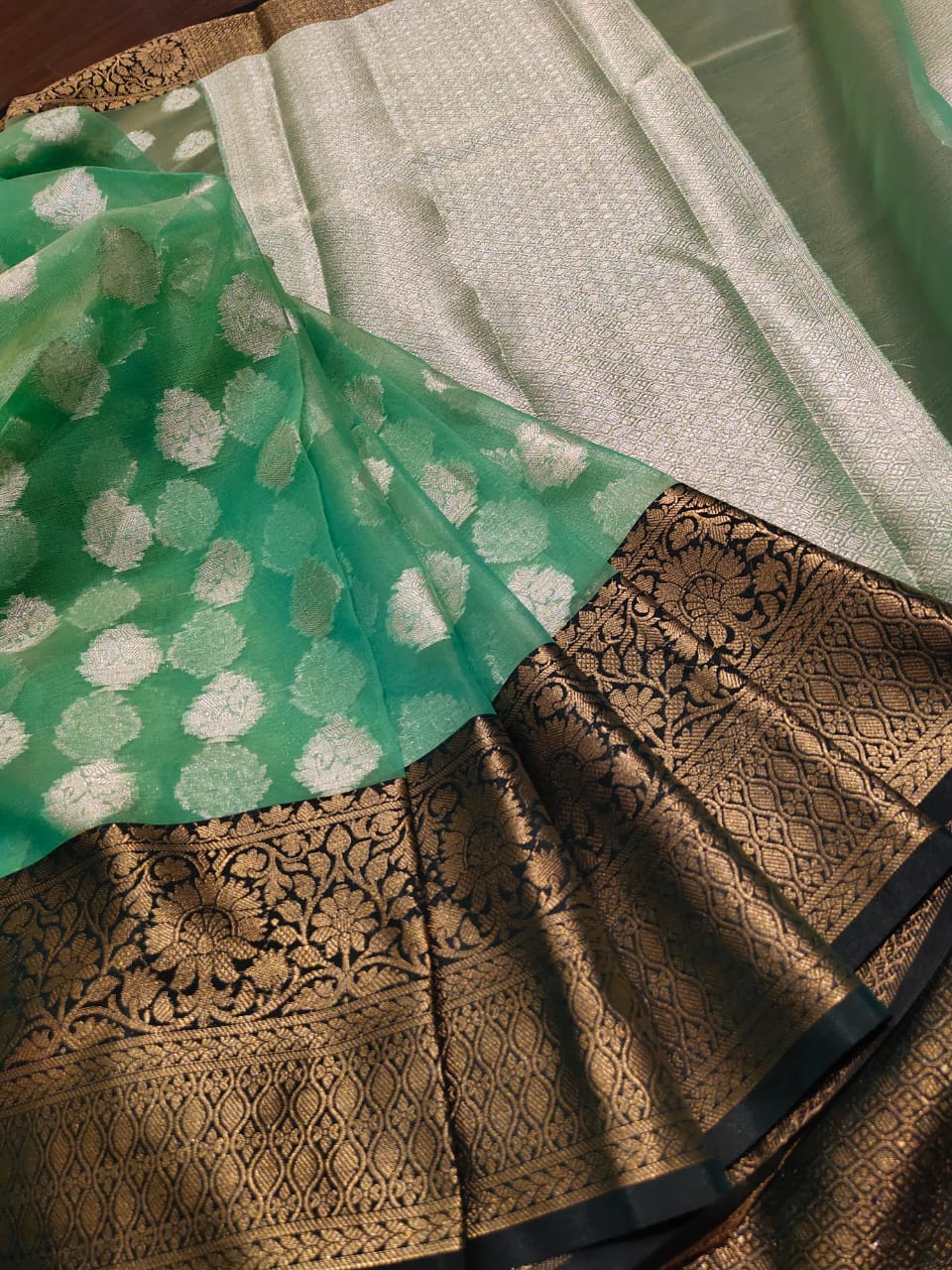 Green kora saree with sliver butties all over and golden zari weaving