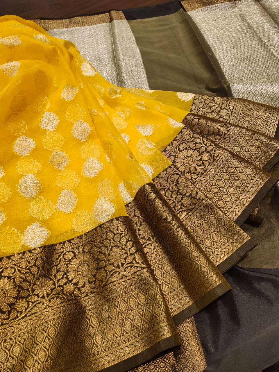 Yellow kora saree with golden zari weaving and silver booties all over