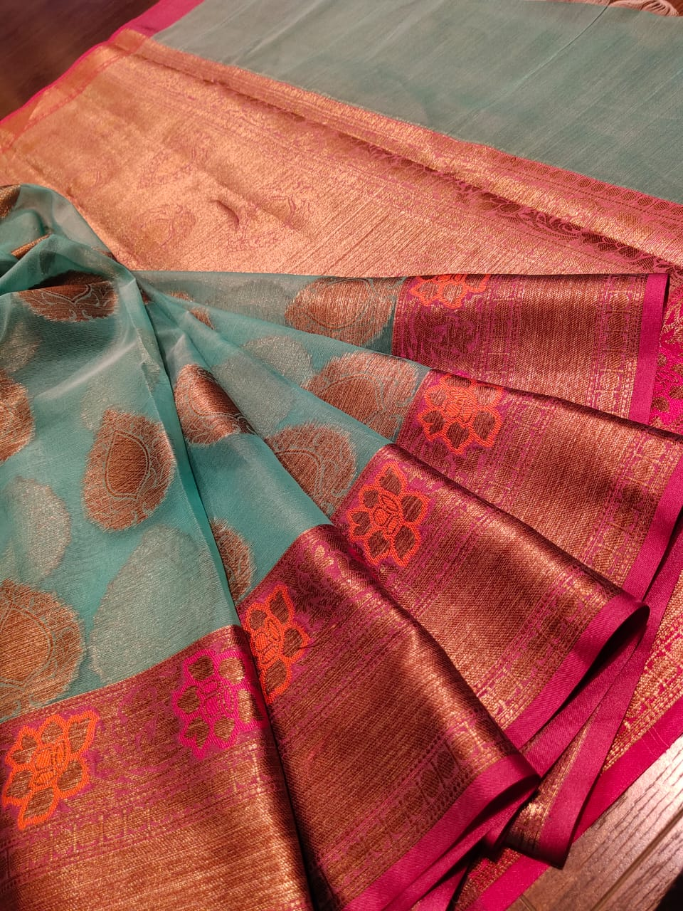 Green kora saree with golden butties and golden zari weaving