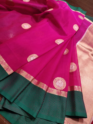 Pink katan tusser silk saree with green border and golden butties all over