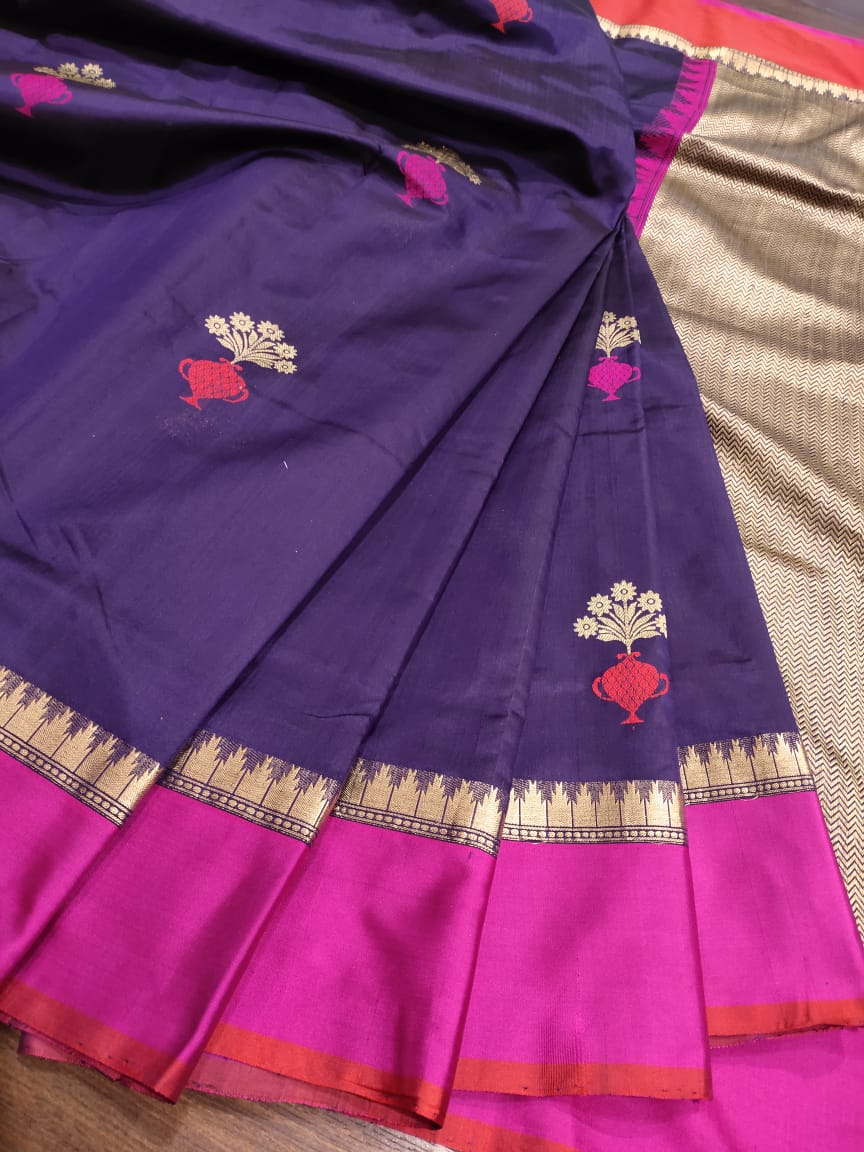 Purple kora silk saree with pink and red border with golden flowers all over