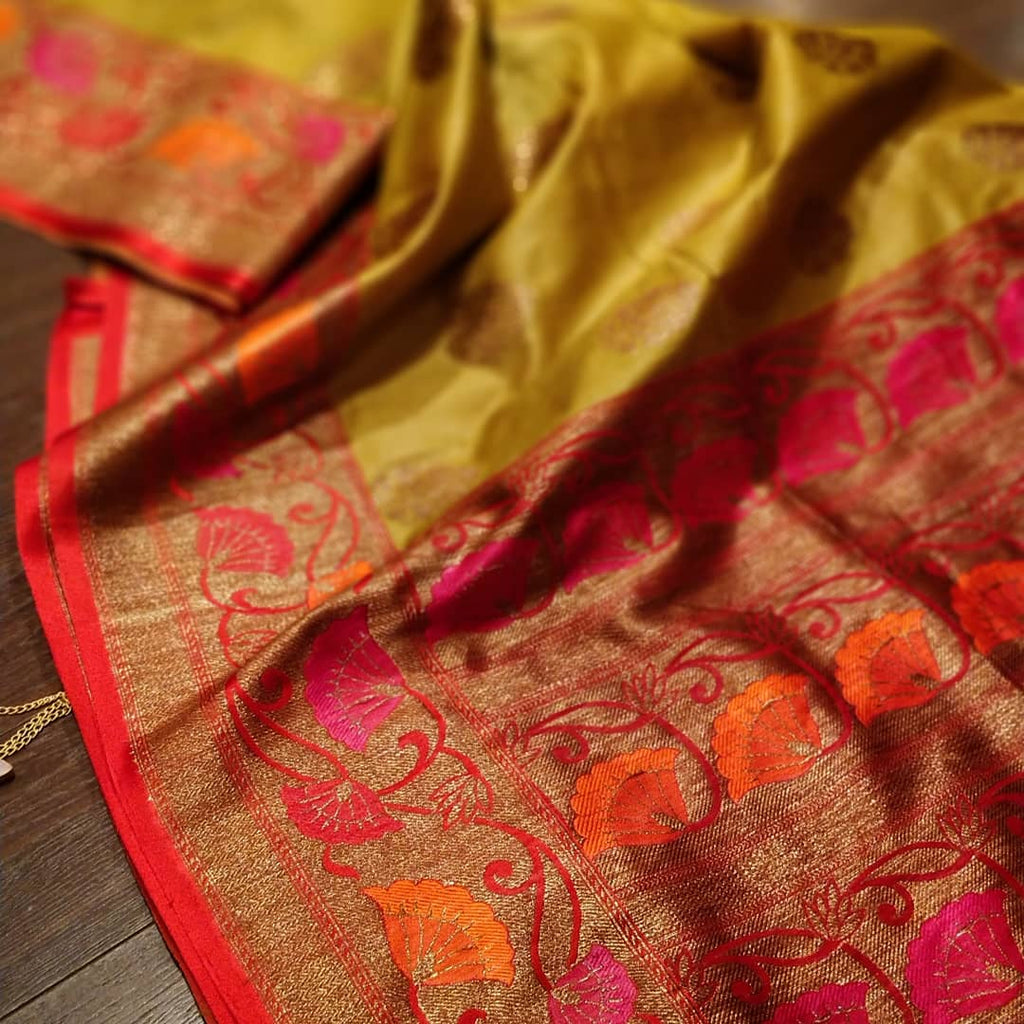 Mustard yellow pure silk saree with golden zari weaving and booties all over