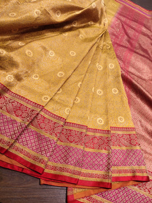 Yellow pure silk saree with golden zari weaving and golden weaving all over