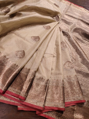 Off white pure silk saree with golden zari weaving and booties all over - EthnicRoom