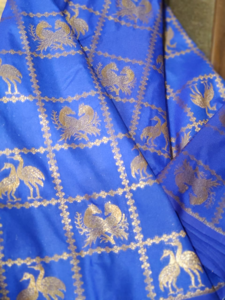 Silk fabric in blue with silver checks zari weaving allover