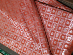 Silk fabric in red with silver checks zari weaving allover