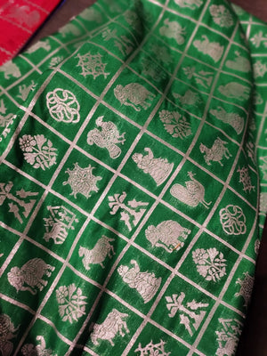 Silk fabric in green with golden checks zari weaving allover