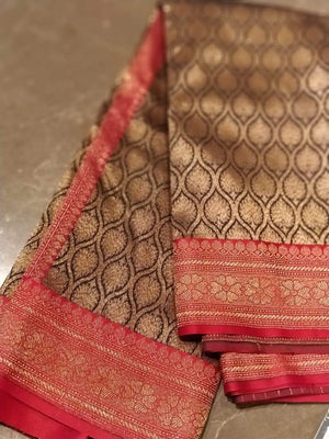Black soft silk saree with golden weaving allover and golden zari weaving on red border