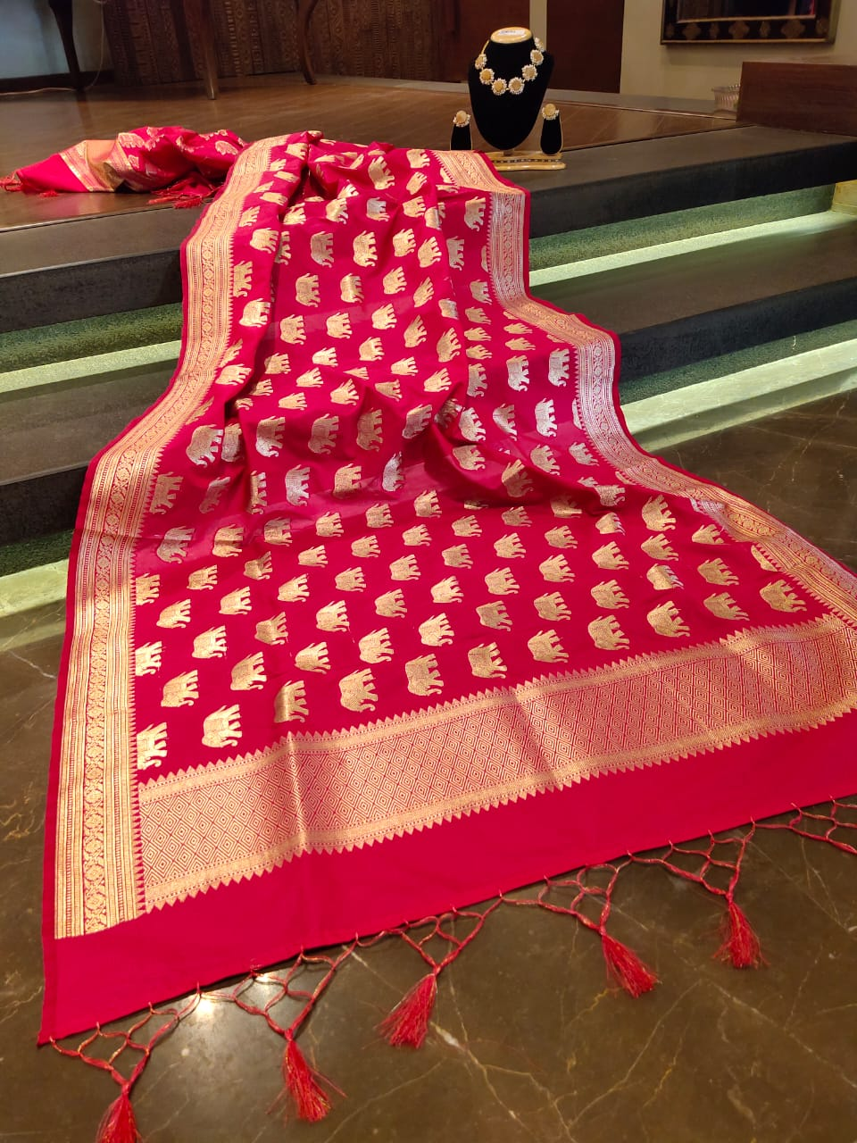 Pink dupatta with golden zari weaving and golden motifs all over