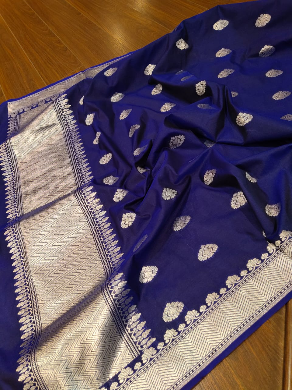 Navy blue dupatta with silver zari weaving and booties all over