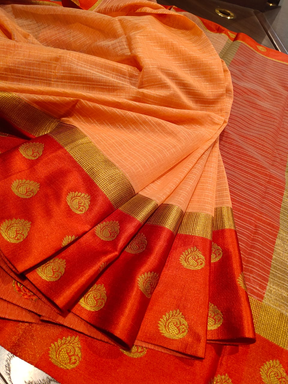 Orange kota saree with red border and golden small border and booties on red border