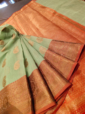 Green linen saree with golden zari weaving and booties all over - EthnicRoom
