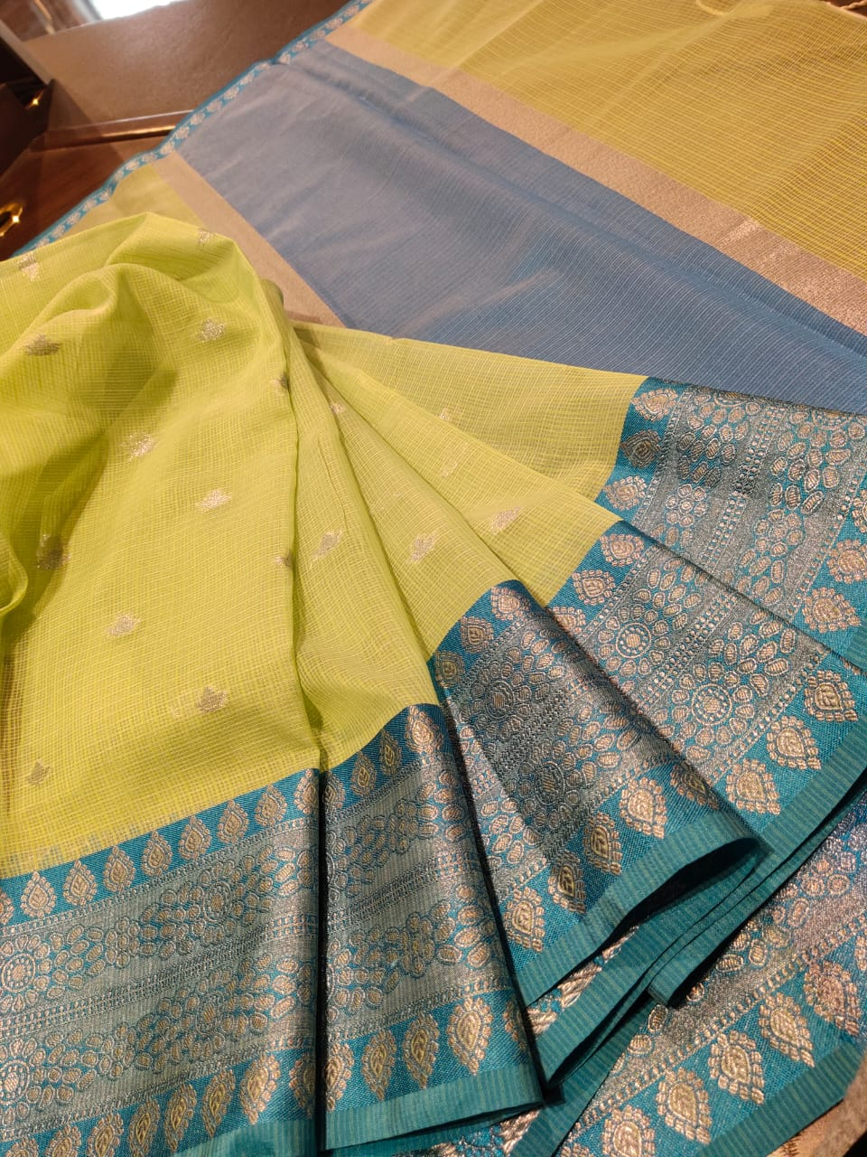 Light green kota saree pink silver zari weaving and silver booties all over