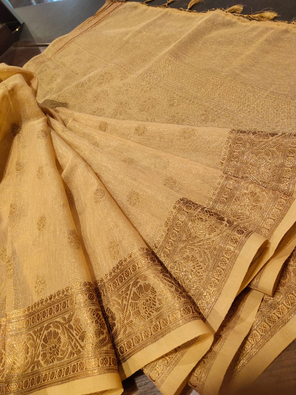 Light mustard yellow kota saree with golden zari weaving and booties all over